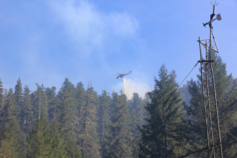 air crane drops water on hot spot of fire