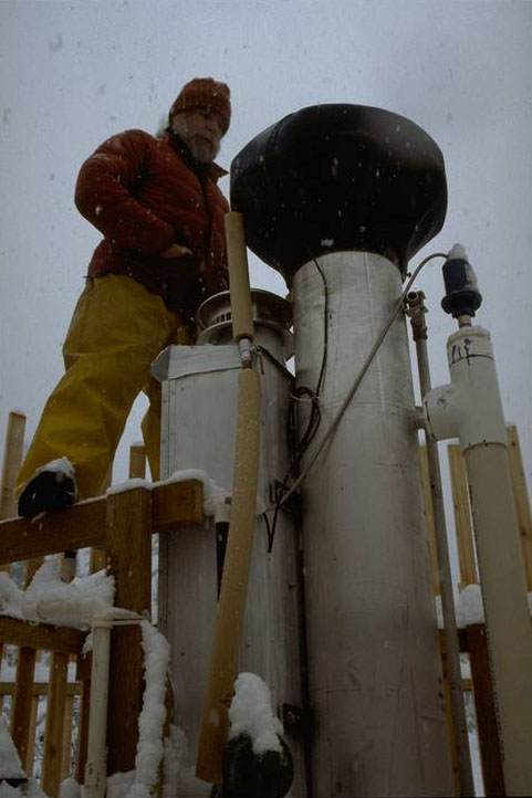 Fred Bierlmaier servicing stand-alone, heated orface rain gage at Uppler Lookout climate station.  Photographed by Al Levno  ..... Date: 11/1994 ..... Photo: AAB-100